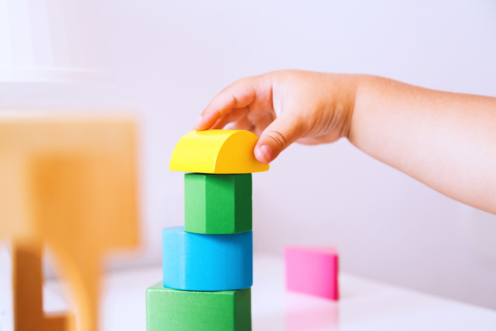 young child stacking blocks